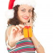 Santa girl in red Christmas hat — Stock Photo