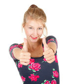 Smiling girl showing thumbs up — Stock Photo