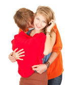 Embracing couple with red heart — Stock Photo