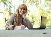 Female student using laptop — Stock Photo