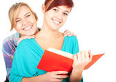 Female friends reading book — Stock Photo