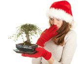 Santa girl in red Christmas hat — Stock Photo