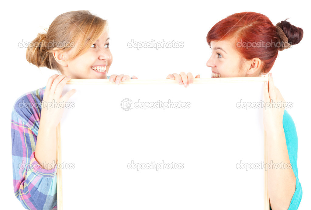 Girl friends holding blank paper, white background — Foto de Stock   #7340624