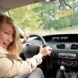 Drunk woman driving a car — Stock Photo #7361381