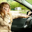 Caling girl driving a car — Stock Photo