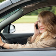 Young woman driving a car — Stock Photo #7361392