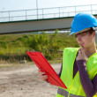Female architect and clipboard — Stock Photo