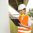 Male engineer in construction site — Stock Photo #7361475