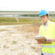 Male engineer in construction site - Stock Photo