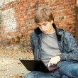 Male student with laptop — Stock Photo #7361493