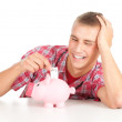 Young man and piggy bank — Stock Photo