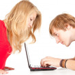 Stock Photo: Couple using laptop