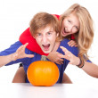 Halloween - young couple with pumpkin — Stock Photo #7361710