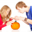 Halloween - young couple with pumpkin — Stock Photo #7361714