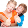 Young couplewith thumbs up — Stock Photo
