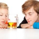 Teenage couple and beer — Stock Photo #7361761