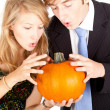 Stock Photo: Halloween - young couple with pumpkin