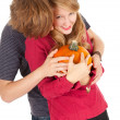 Halloween - young couple with pumpkin — Stock Photo #7361783