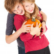 Halloween - young couple with pumpkin — Stock Photo #7361787
