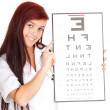 Foto Stock: Doctor womwith optometry chart