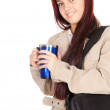 Girl with big mug and laptop bag — Stock Photo