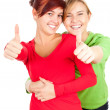 Female friends with thumbs up — Stock Photo #7361878