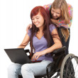 Invalid girl with laptop and friend — Foto Stock