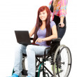 Invalid girl with laptop and friend — Stock Photo #7361907