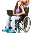 Invalid girl with laptop and friend — Stock Photo #7361909