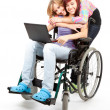 Invalid girl with laptop and friend — Stock Photo #7361910