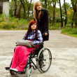 Invalid girl with friend — Foto Stock