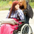 Invalid girl with friend — Stock Photo #7361928