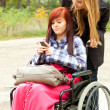 Invalid girl with friend — Stock Photo #7361930