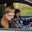 Girl friends in car - Stockfoto