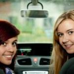 Girl friends in car — Stock Photo