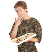 Young man with chocolates — Stock Photo
