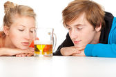 Teenage couple and beer — Stock Photo