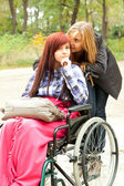 Invalid girl with friend — Stock Photo