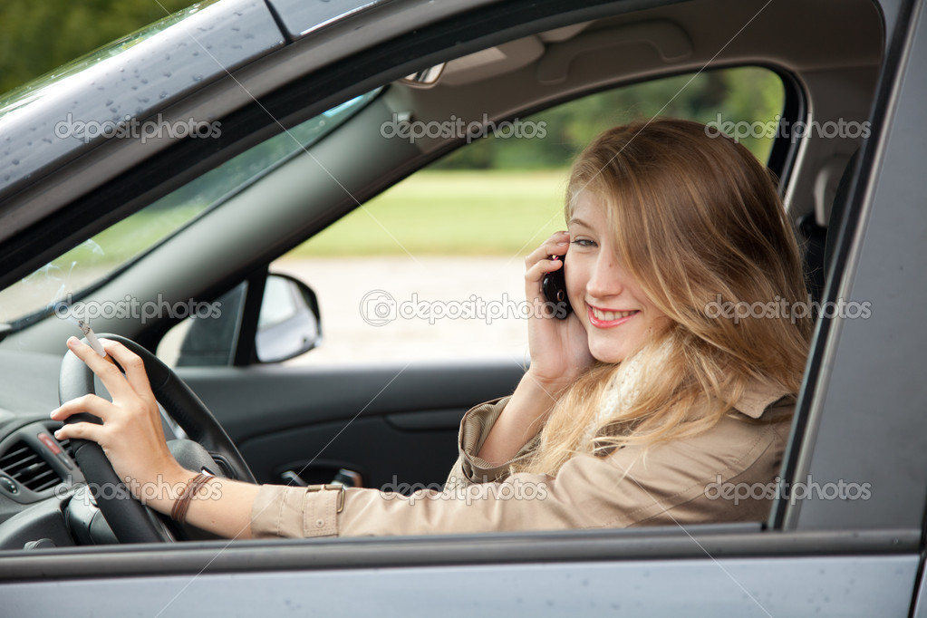 Young beautiful woman driving her new car — Stock Photo #7361392