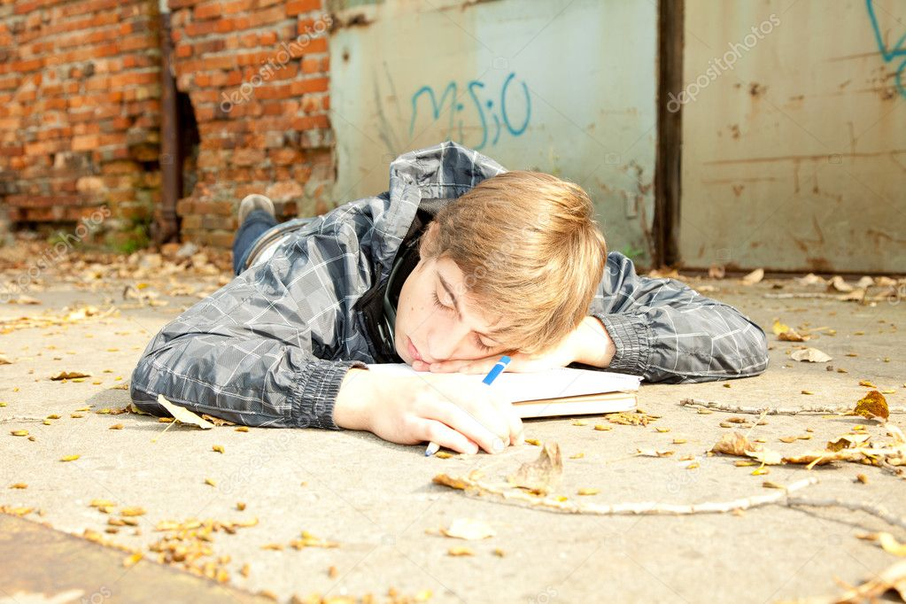 Sleeping male student learning in the park  Stock Photo #7361497