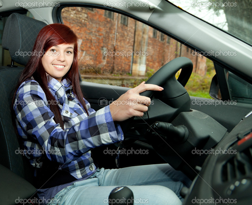 Young beautiful woman driving her new car — Stock Photo #7361944