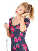 Girl enjoying music — Stock Photo