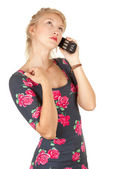 Girl speaks by a mobile phone — Stock Photo