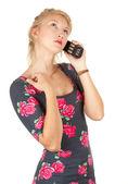 Mädchen spricht über ein mobiltelefon — Stockfoto