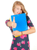 Student girl with thumb up and books — Stock Photo