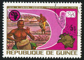 GUINEA CIRCA 1974: stamp printed by Guinea, shows Drummers, Pigeon, Universal Postal Union Emblem, circa 1974 — Zdjęcie stockowe
