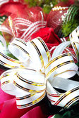 Holiday ribbon on the flower — Stock Photo