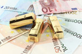 Gold bars and Euro — Stock Photo