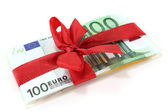 Euro with red ribbon — Stock Photo