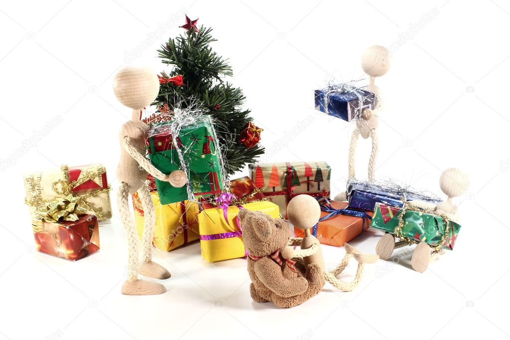 Dolls at the handing out of presents and Christmas tree with gifts — Stock Photo #7586423